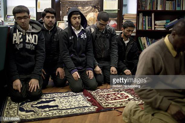 Senior high school boys at the Al Noor School pray with their instructor January 19 2011 in the Brooklyn borough of New York The Al Noor School is a...
