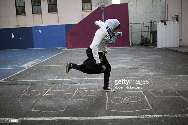 Senior high school girl at the Al Noor School plays hopscotch during a free period December 15 2010 in the Brooklyn borough of New York The Al Noor...