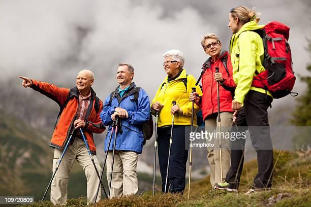 senior hiker pointing at something