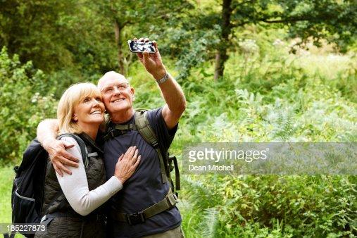 Senior hikers taking their self portrait
