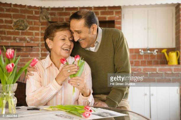Senior Hispanic couple hugging