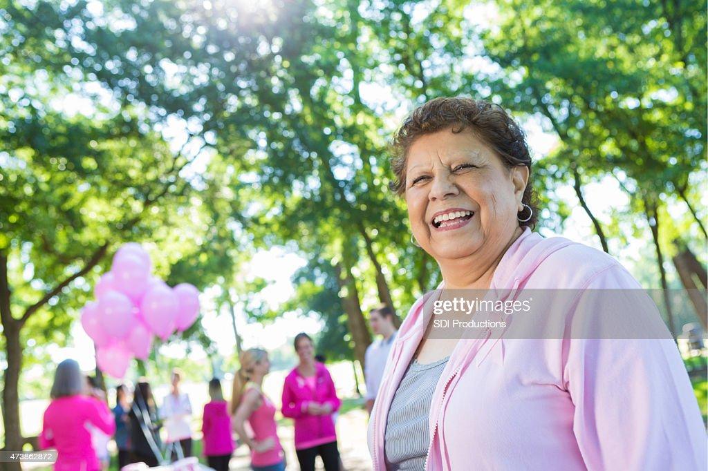 Senior Hispanic woman is survivor at breast cancer awareness race