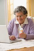 Senior Hispanic woman looking up medication online