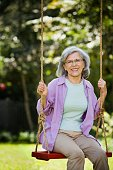 Senior Hispanic woman on swing