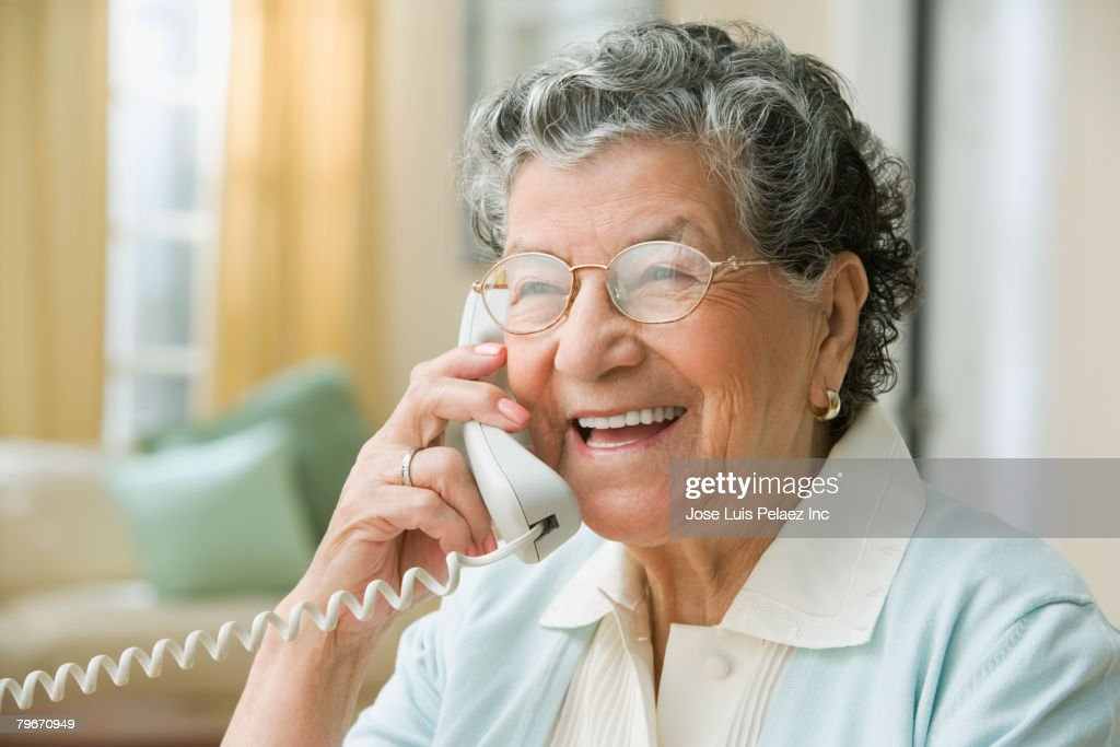 Senior Hispanic woman talking on cell phone