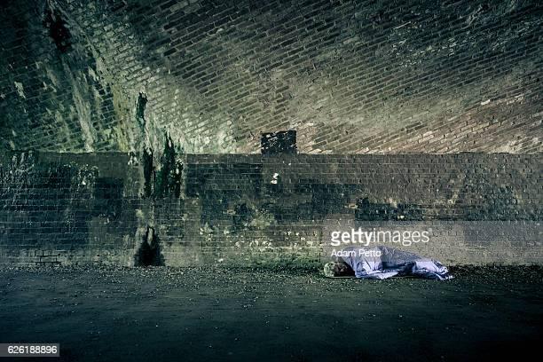 Senior homeless caucasian male sleeping rough outdoors
