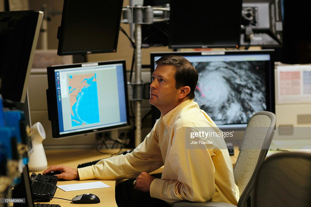 Senior Hurricane Specialist Daniel Brown studies computer models as he tracks Hurricane Irene at the National Hurricane Center on August 24, 2011 in Miami, Florida. Irene is on track to move over the Bahamas as a category 3 storm and from there cooler ocean temperatures are expected to lessen the wind speeds, but it could still be a major storm as it approaches the North Carolina coast August 27.