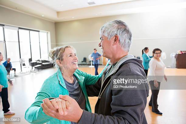 Senior husband and wife take dance lessons