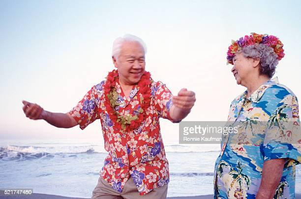 Senior in Hawaii doing the hula on a beach