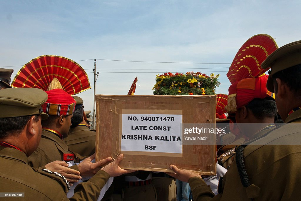 Senior Indian Border Security Force (BSF) officers carry a coffin containing the body of their killed comrade, Krishna Kalita, after a wreath-laying ceremony on March 22, 2013 in Srinagar, the summer capital of Indian administered Kashmir, India. A wreath-laying ceremony was held by the BSF for their killed comrade after suspected rebels shot him dead yesterday and wounded two others when they fired on their vehicle on a highway. Kashmir valley is on the alert since the hanging of Afzal Guru, a local resident who was convicted of carrying out a deadly attack on the Indian Parliament in 2001.