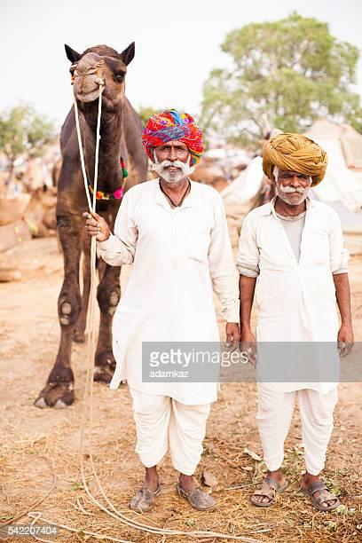 Senior Indian Men Selling Camel