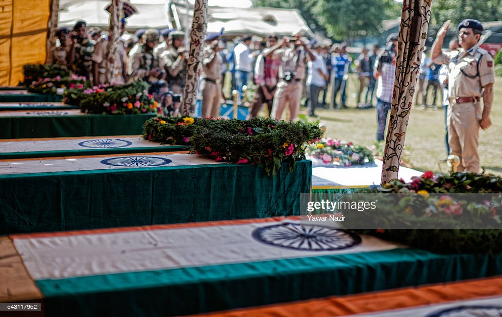 Senior Indian Paramilitary officer of Central Reserve Police Force (CRPF) salutes the coffins containing bodies of their killed comrades during a wreath-laying ceremony of eight CRPF soldiers killed in an ambush on June 26, 2016 in Srinagar, the summer capital of Indian Administered Kashmir, Indian. Eight Indian Central Reserve Police Force troopers were killed and another twenty critically wounded on Saturday after pro freedom rebels ambushed a paramilitary convoy on the Srinagar-Jammu highway near Pampore in Jammu and Kashmir's Pulwom district, police said. The firing was returned and two rebels were killed in the retaliatory action by the CRPF troopers. A wreath-laying ceremony was held today by the CRPF for their killed comrades.