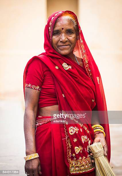 Senior Indian Woman Dressed in Traditional Attire Cleaning