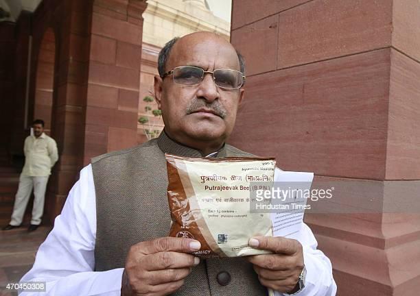 Senior Janata DalUnited leader KC Tyagi showing a packet of Putrajeevak Beej a medicinal product of Yoga guru Baba Ramdev that guarantees birth of a...