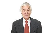studio shot of senior Japanese businessman on white background