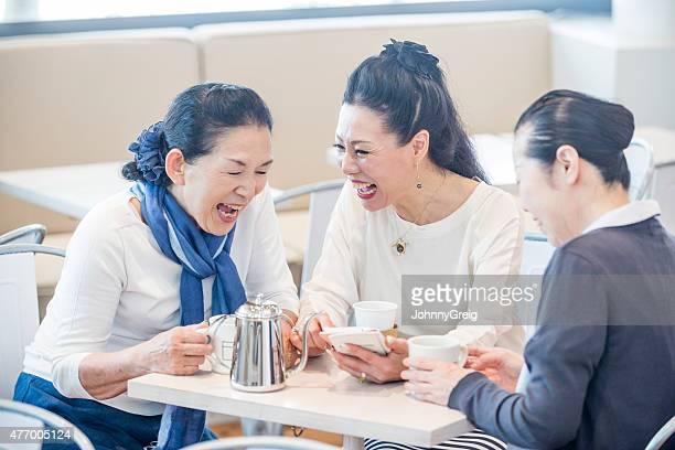Senior Japanese enjoying a joke together