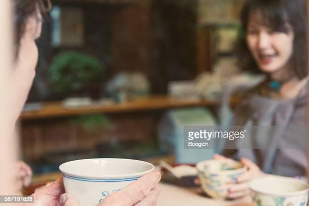 Senior Japanese Friends Enjoying Desert at Restaurant in Kyoto Japan