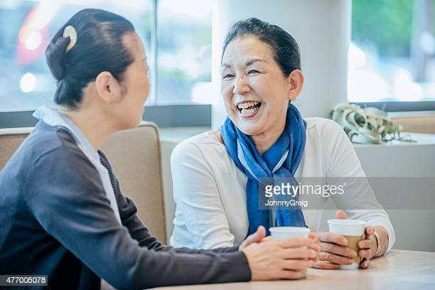 Senior Japanese woman laughing with a friend