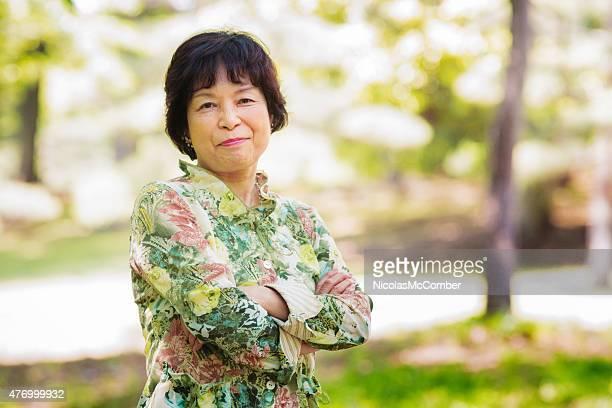 Senior Japanese woman smiling with confidence in Yoyogi Park Tokyo
