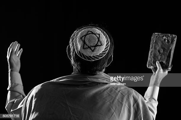 Senior jewish man praying ,holy book in hand