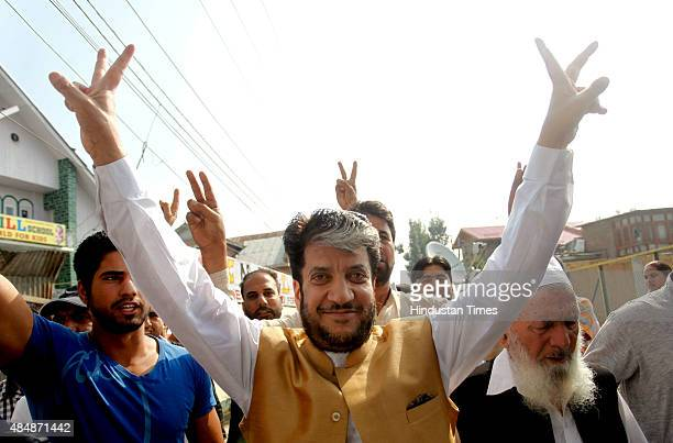 Senior Kashmiri separatist leader and Chairman of Democratic Freedom Party Shabir Ahmad Shah shows the victory sign prior to his departure for New...