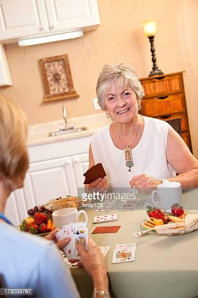 Senior ladies enjoying a game of cards.
