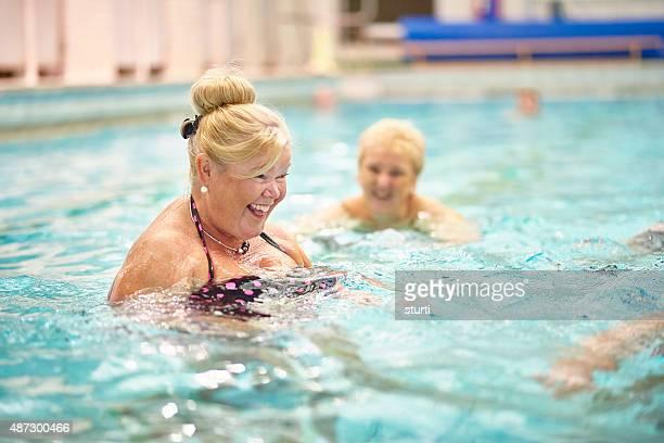 senior ladies having fun in pool