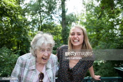 Senior (98) lady and young woman laughing in park : Stockfoto