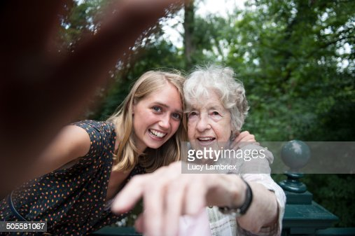 Senior (98) lady and young woman making a selfie : Stockfoto
