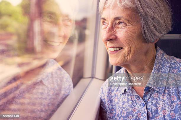 Senior lady on a train