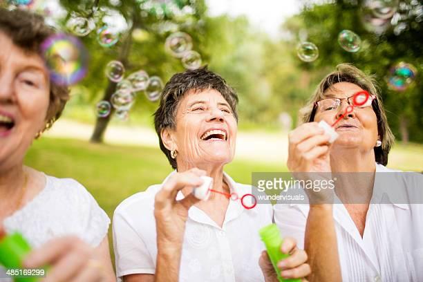 Senior ladys blowing bubbles