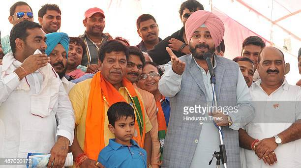 BJP senior leader and former Indian cricketer Navjot Singh Sidhu with Panchkula candidate Gian Chand Gupta during the election campaigning on October...