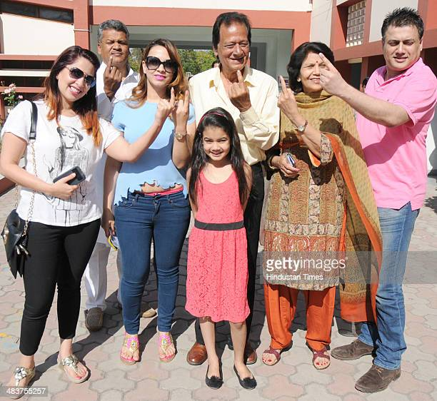 BJP senior leader and former minister Harmohan Dhawan with his family members after casting their vote in sector 9 polling both for the General...