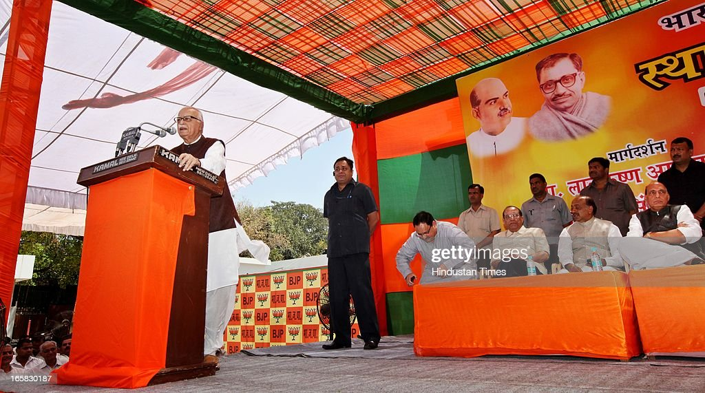 BJP Senior leader L K Advani addressing the party members while BJP President Rajnath Singh looks on, at BJP Headquarter on the occasion of 33rd foundation day of BJP April 6, 2013 in New Delhi, India. In 1980, the leaders and workers of the former Bharatiya Jana Sangh, founded the Bharatiya Janata Party with Vajpayee as its first president.