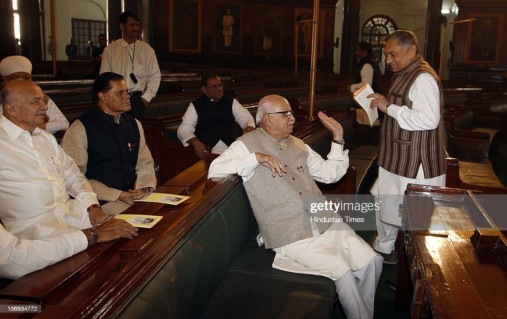 BJP senior leader L K Advani and Congress leader Janardhan Dwivedi interact after paying tributes to the former Prime Minister Indira Gandhi on her 95th birth anniversary at Parliament House on November 19, 2012, in New Delhi, India.