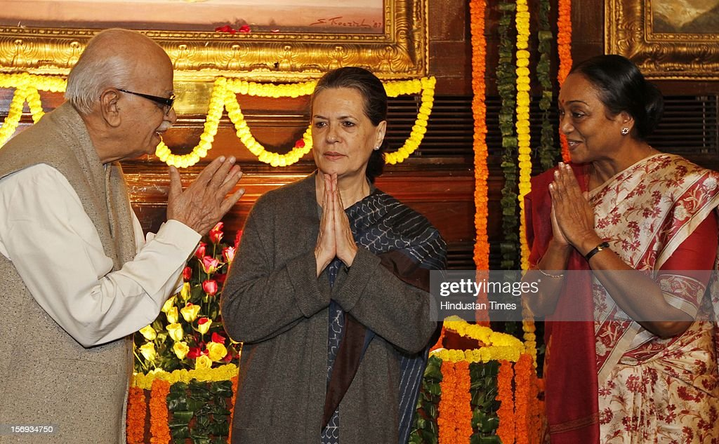 BJP senior leader L K Advani exchanges greetings with UPA Chairperson <a gi-track='captionPersonalityLinkClicked' href=/galleries/search?phrase=Sonia+Gandhi&family=editorial&specificpeople=2287581 ng-click='$event.stopPropagation()'>Sonia Gandhi</a> and Lok Sabha Speaker Meira Kumar after paying tributes to the former Prime Minister Indira Gandhi on her birth anniversary at Parliament House on November 19, 2012, in New Delhi, India.