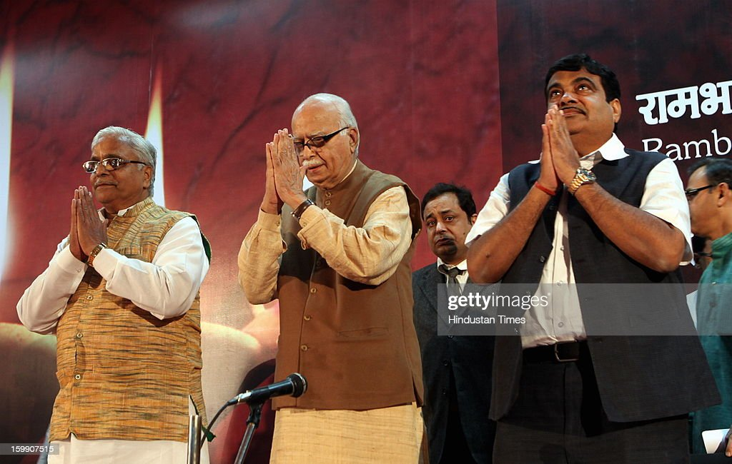 BJP Senior leader LK Advani (C) with BJP president Nitin Gadkari (R) and RSS general secretary Suresh Joshi alias Bhaiyaji Joshi (L), as Gadkari declares his resignation as BJP President during the occasion of 30th year completion celebration of Rambhau Mhalgi Prabodhini at Uttan Bhayander on January 22, 2013 in Mumbai, India.
