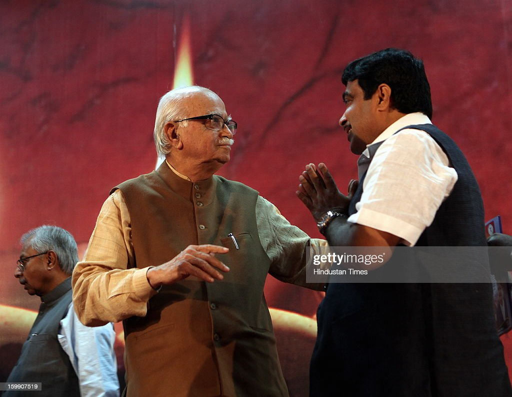 BJP Senior leader LK Advani (L) with BJP president Nitin Gadkari (R), as Gadkari declares his resignation as BJP President during the occasion of 30th year completion celebration of Rambhau Mhalgi Prabodhini at Uttan Bhayander on January 22, 2013 in Mumbai, India.