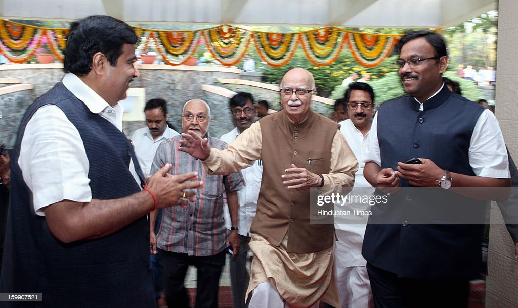 BJP Senior leader LK Advani (C) with BJP president Nitin Gadkari (L), as Gadkari declares his resignation as BJP President during the occasion of 30th year completion celebration of Rambhau Mhalgi Prabodhini at Uttan Bhayander on January 22, 2013 in Mumbai, India.