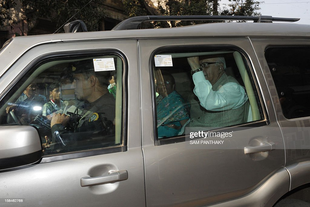 Senior leader of Bharatiya Janta Party (BJP) Lal Krishna Advani (R) and his wife and his wife Kamla Advani (2nd R) leave the Gujarat BJP headquarters in Ahmedabad on December 17, 2012. Millions of Indians are voting in the final stage of Gujarat state elections with Hindu nationalist Narendra Modi seeking a clear victory to bolster his prime ministerial ambitions in 2014. AFP PHOTO/Sam PANTHAKY