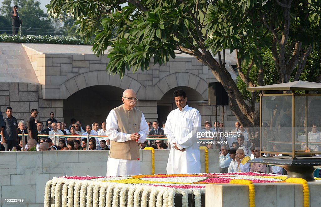 Senior leader of India's main opposition Bharatiya Janata Party (BJP) Lal Krishna Advani pays his respects at the memorial to the Father of the Nation Mahatma Gandhi at Rajghat in New Delhi on October 2, 2012, in honour of Gandhi's 143rd birth anniversary. Indians all over the country are celebrating the founding father's birthday with prayers and social activities as a mark of respect to Gandhi, famed as the torchbearer of India's fight against British rule.