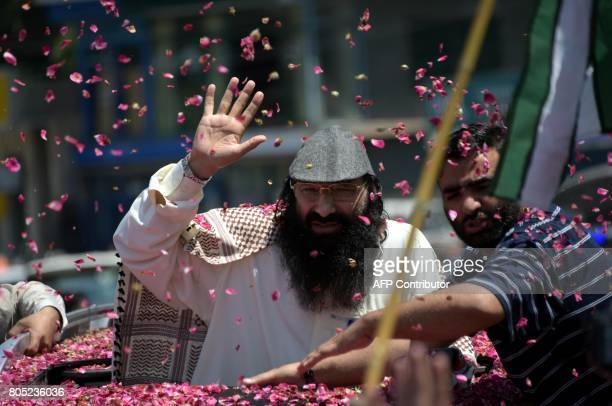 Senior leader of Kashmiri militant group HizbulMujahideen Syed Salahuddin gestures as he arrives for a press briefing in Muzaffarabad on July 1 2017...