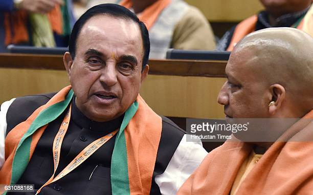 BJP senior leaders Subramanian Swamy and Yogi Adityanath during the National Office Bearers Meeting at NDMC Convention Centre on January 6 2017 in...