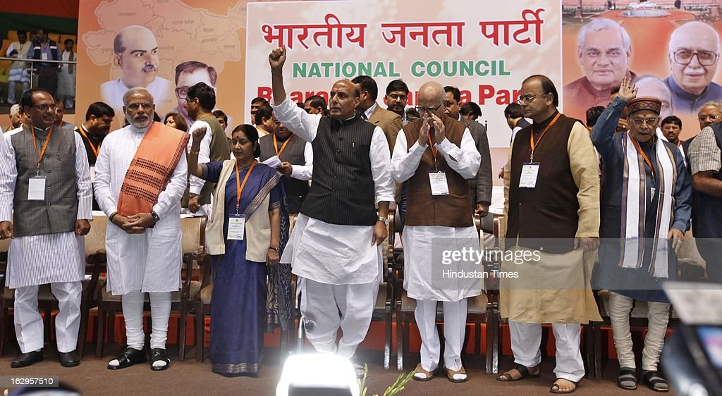 Senior leadership of BJP (L-R) Madhya Pradesh Chief Minister Shivraj Singh Chauhan , Gujarat CM Narendra Modi, Sushma Swaraj and BJP President Rajnath Singh and senior party leader L K Advani, Arun Jaitley, Murli Manohar Joshi, Nitin Gadkari, M Venkaiah Naidu and other leaders present on dais during Bharatiya Janata Party National Council meeting at Talkatora Indoor Stadium on March 2, 2013 in New Delhi, India. In his 90 minute presidential address Rajnath Singh asked the party ranks to be prepared for early Lok Sabha polls and crucial assembly elections this year, including in Karnataka, Madhya Pradesh, Chhattisgarh, Rajasthan and Delhi all very important states for BJP.