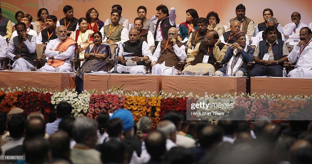 Senior leadership of BJP (L-R) Madhya Pradesh Chief Minister Shivraj Singh Chauhan , Gujarat CM Narendra Modi, Sushma Swaraj and BJP President Rajnath Singh and senior party leader L K Advani, Arun Jaitley, Murli Manohar Joshi, Nitin Gadkari, M Venkaiah Naidu and other leaders present on dais during Bharatiya Janata Party National Council meeting at Talkatora Indoor Stadium on March 2, 2013 in New Delhi, India. In his 90 minute presidential address Rajnath Singh asked the party ranks to be prepared for early Lok Sabha polls and crucial assembly elections this year, including in Karnataka, Madhya Pradesh, Chhattisgarh, Rajasthan and Delhi all very important states for BJP.