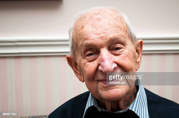 Senior male 88 years old smiling in his living room