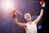 Senior male boxer cheering