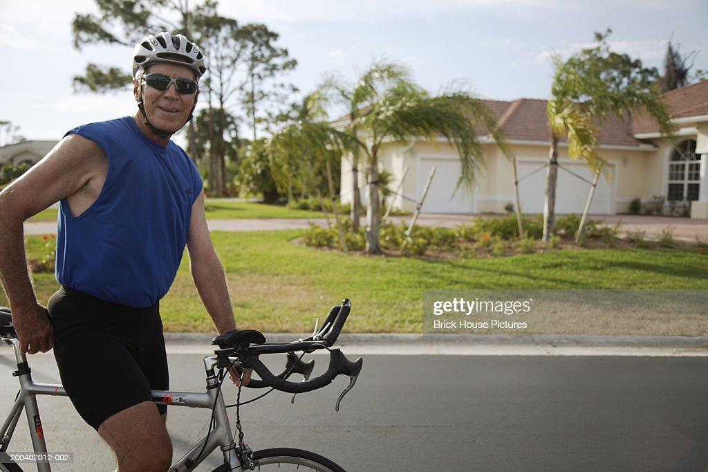 Senior male cyclist, portrait : Stock Photo