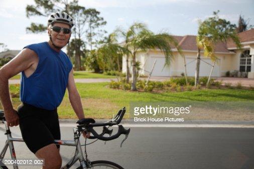 Senior male cyclist, portrait : Stock Photo