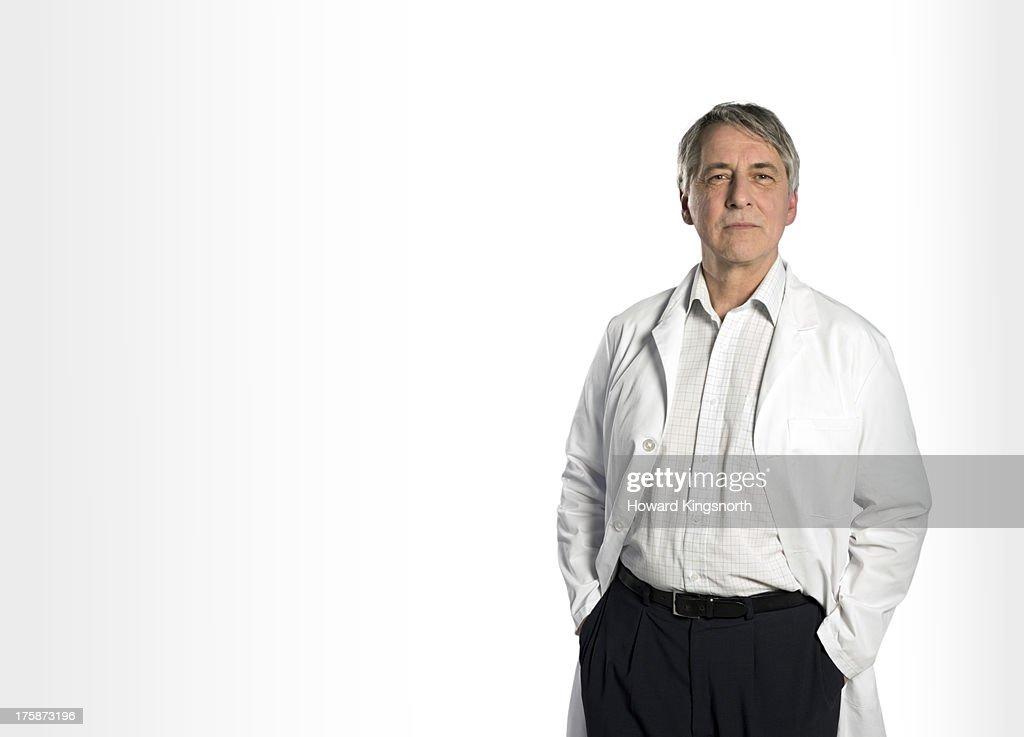senior male doctor standing